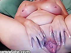 Big breasted mature plays with her BIG pussy