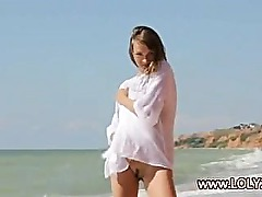 Striptease on the beach