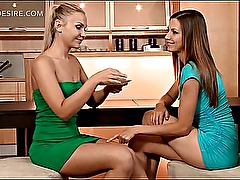 Sexy lesbian duo making out on the kitchen table