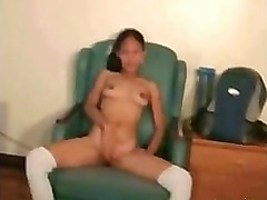 Petite Asian girl bangs herself with sex toy