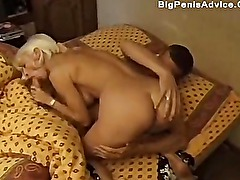 The young man wakes up to fuck the mature