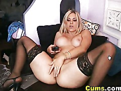 Busty babe masturbates and cums on cam
