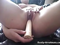 Busty Jennifer masturbating her bald pussy with dildo