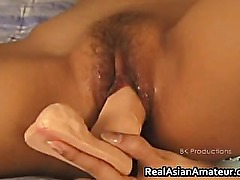 Teen asian shoves a huge dildo into her part4