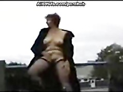 Horny GF gets naked in the street and masturbates
