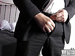 Smart guy in suit wanks his big hard cock in frilly nylon panties