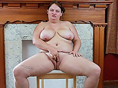 Marcella fingers her fat pussy