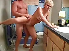 Mature blonde sex in the bathroom