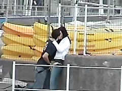 Guy play with his girl in the harbor, hidden cam.