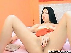 Dark haired girl masturbates with a dildo on webcam