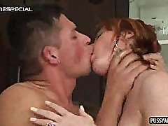 Redhead babe sucking and tugging on a hard cock