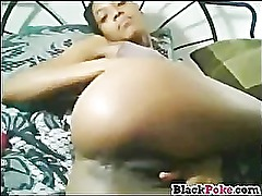 Hot black babe teasing and dildoing pussy