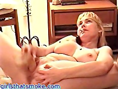 Chubby blonde dildos while one the phone and smoking