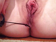 Hot chick with shaved pussy masturbates with anal beads