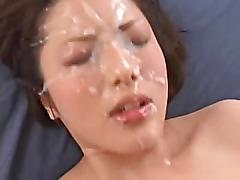 Hot asian babe gets her face covered with hot steamy jizz