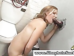 Gloryhole slut gives fat black cock footjob