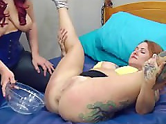 Dominatrix squirts her sexy subslut in mouth and body with pee. Watersports