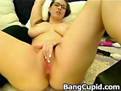 Busty babe spreads her legs and masturbating