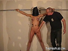 Hooded amateur bdsm and big tit whipping of Danii in bondage and dungeon punishm