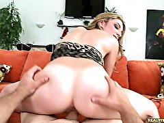 This cute blonde loves riding huge cock .