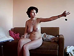 Amateur strips and takes naked pictures while recording