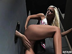 Busty blond Britney Amber enjoys fucking in glory hole.