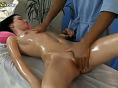 Gentle brunette Lily enjoys this oiled massage scene! Professional masseurs hands caress her small tits and start to rub her tiny, tight pussy, presenting her unforgettable feelings.