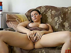 Lovely and busty dark haired amateur babe Blanka spreads her legs and plays with her bushy and wet fish lips on the living room couch in front of the camera and enjoys herself