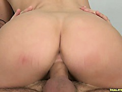 Victoria rides a hard cock in the reverse cowgirl position.