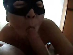 Masked Chinese chick sucks cock
