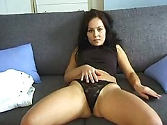 Hot brunetter playing with her pussy