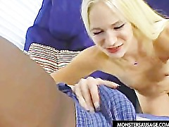 Blonde girl handles huge cock