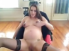 Tattooed Pregnant Babe Masturbating