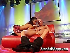 Couple fucking on stage during live sex show