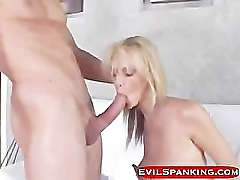 Blonde slut deep throating after some sexy spanking