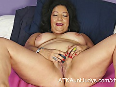 Isis toys her MILF pussy.