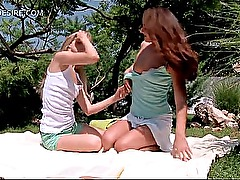 Desirable lesbo teen beauties kiss and touch outdoor
