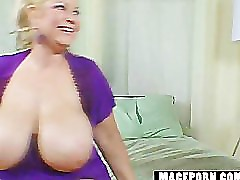 Blonde with huge tits plays
