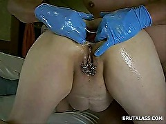 Pierced woman gets her asshole fisted by a blue glove